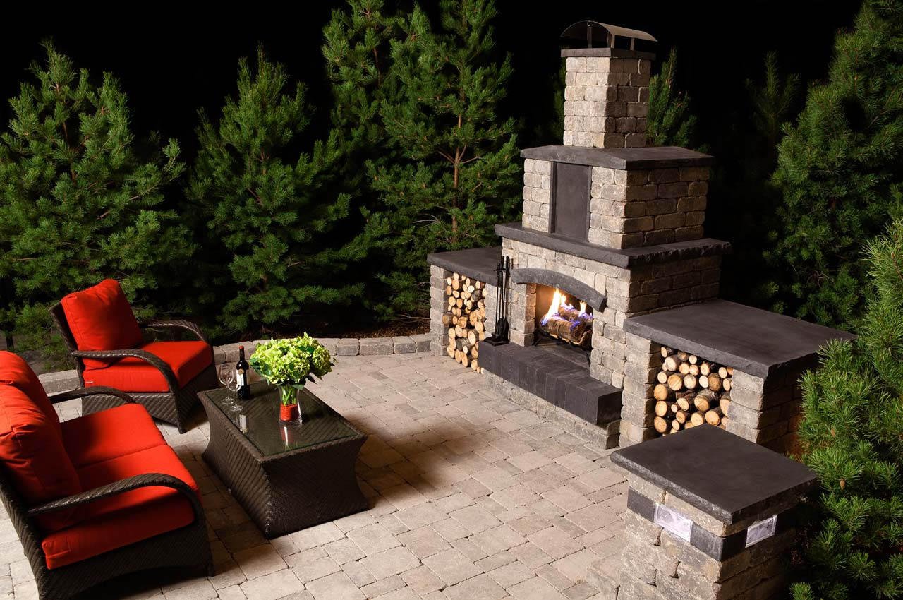 Stone Oasis Fireplace with Roman Patio